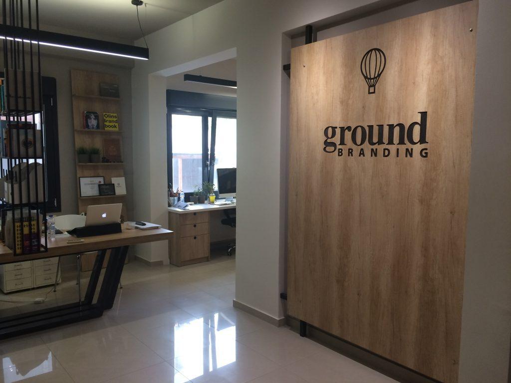 Ground Branding's logo carved on wood